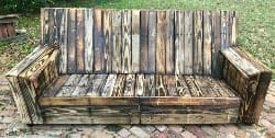 traditional furniture - Custom Torch Fired Pallet Wood Patio Sofa