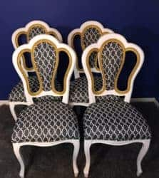 Matte white accent dining chairs with gold glitter accent