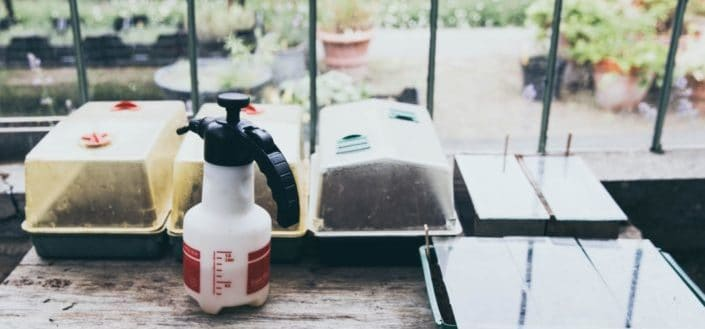 A spray bottle on top of table