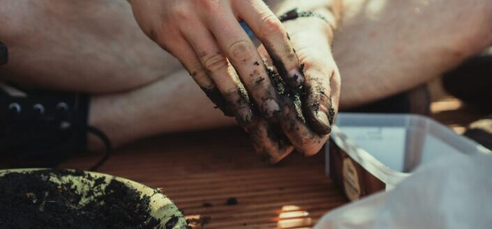 hands working with soil