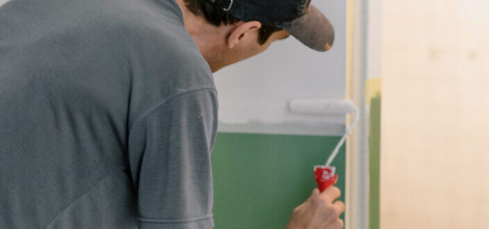 Guy painting his wall white