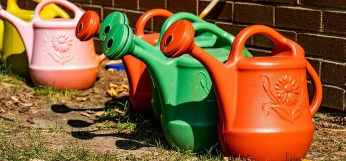 Watering cans in different colors