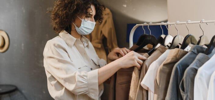 woman choosing on a cloth rack