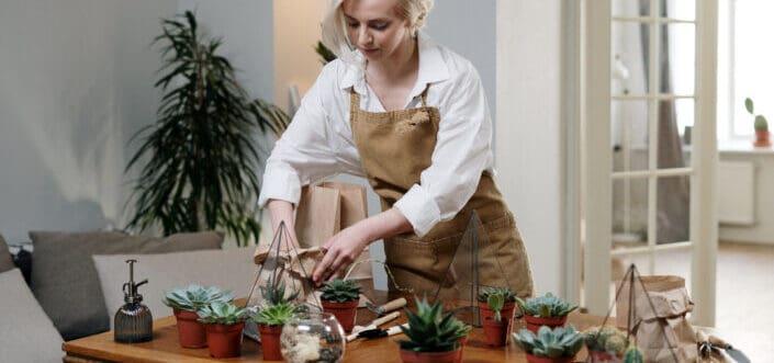 Woman tending her succulents.